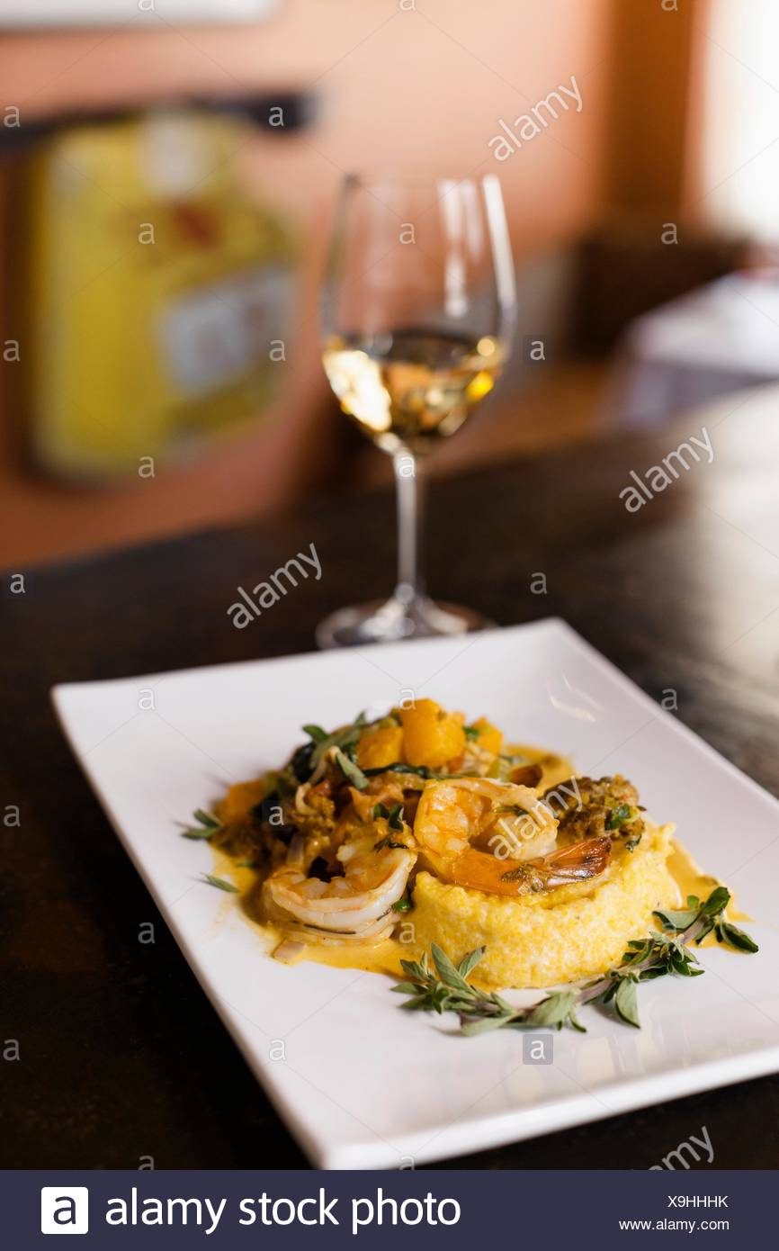 Shrimp and grits, wine pairing - Stock Image