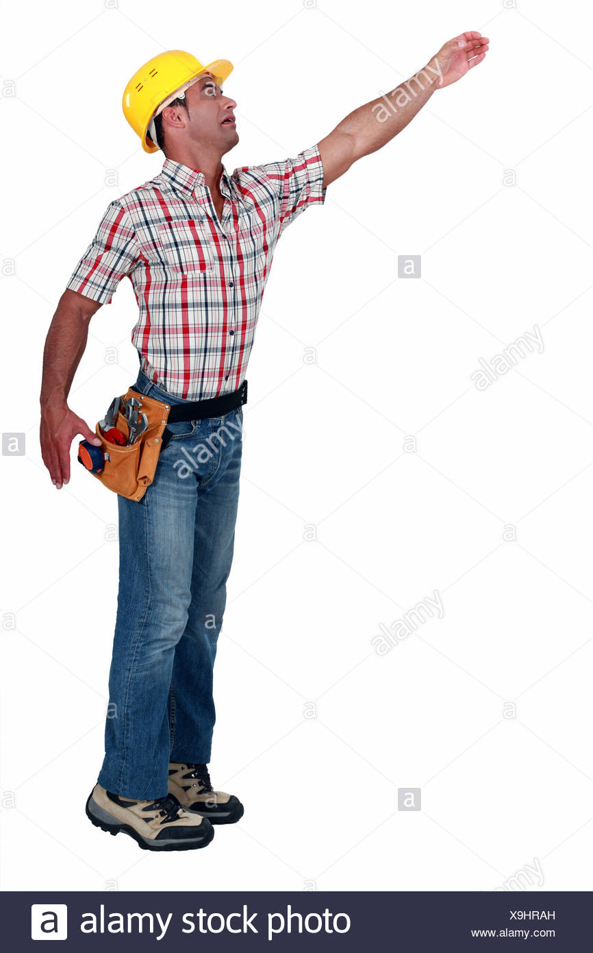 Construction worker reaching for something - Stock Image