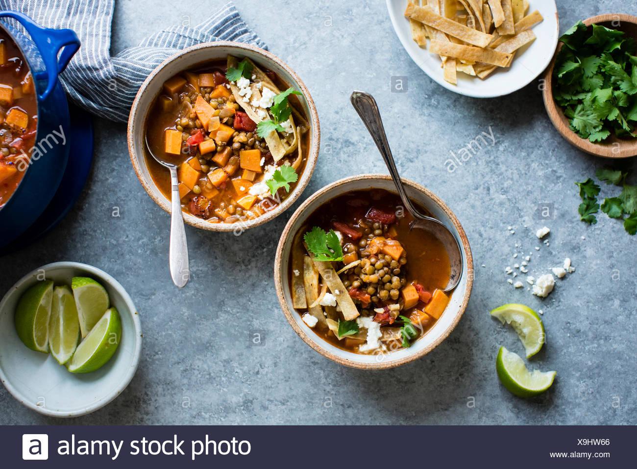 Smoky Sweet Potato & Lentil Tortilla Soup, gluten free and vegan. - Stock Image