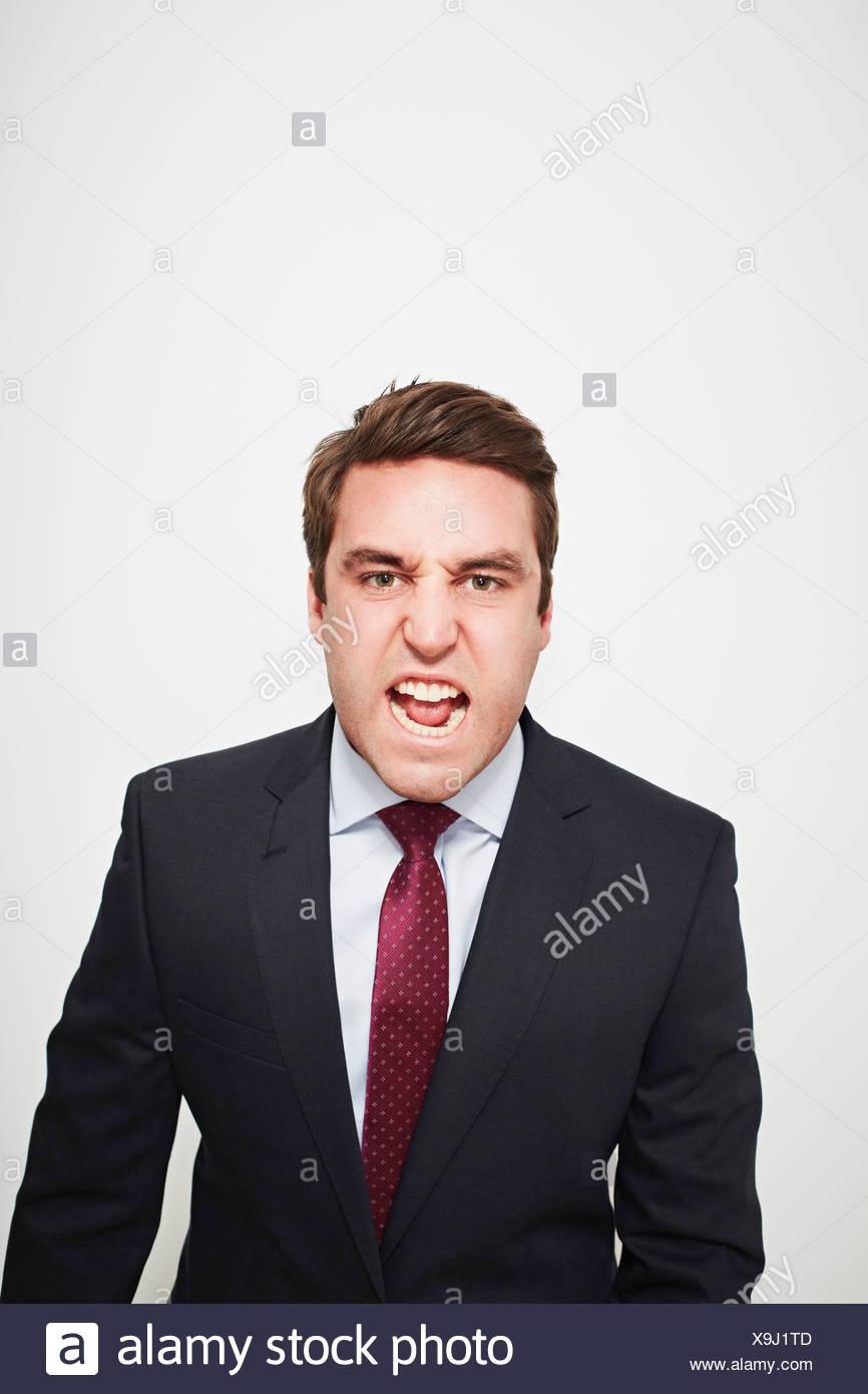 Businessman yelling indoors - Stock Image