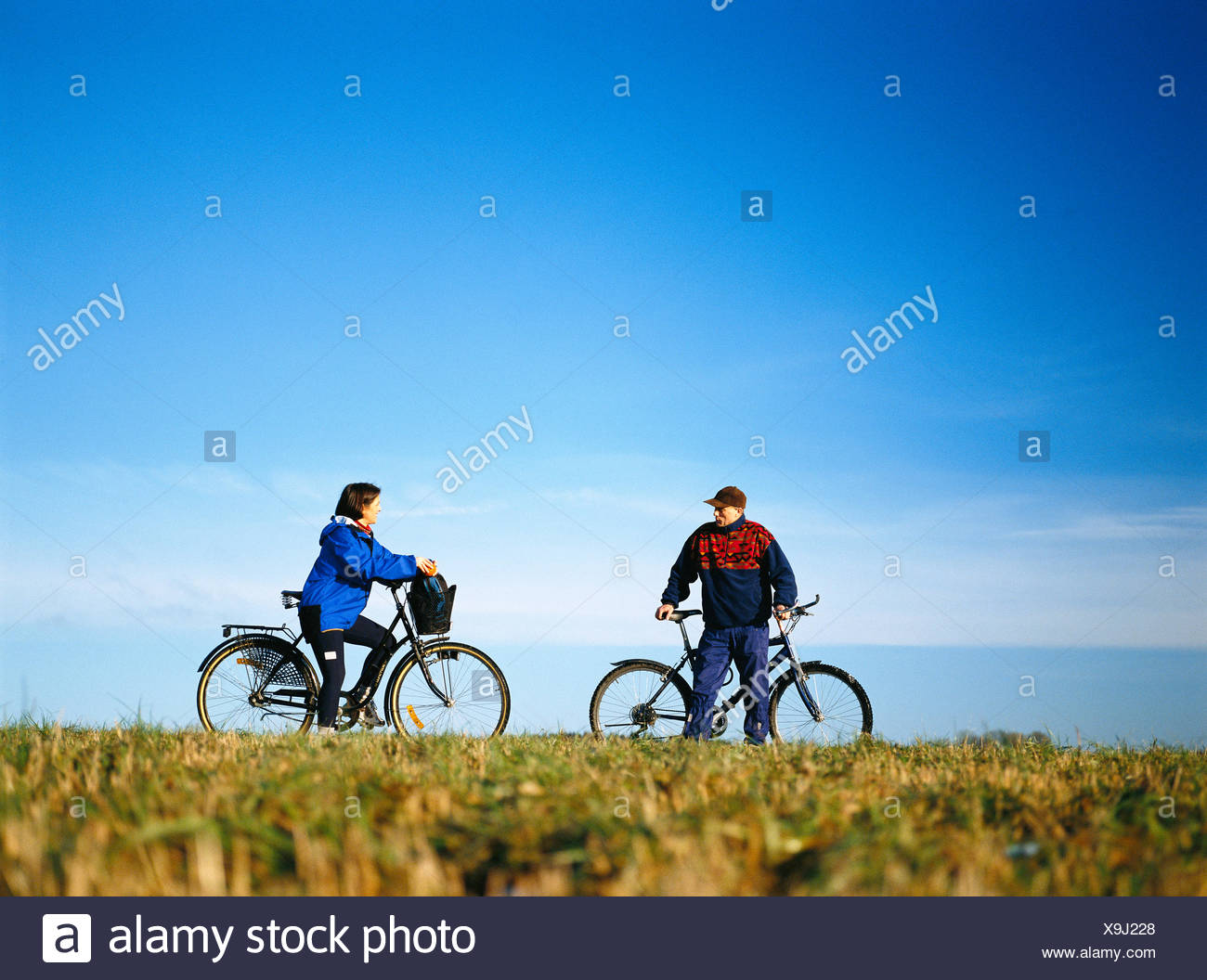35-39 years 45-49 years activity adults only autumn blue casual clothing catalogue 2 clear sky color image cultivated field - Stock Image