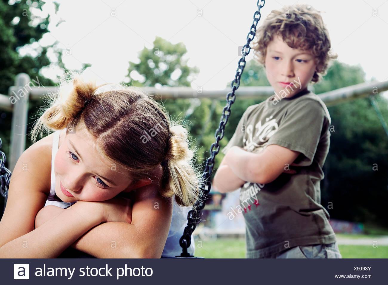 41427ff2e7ef6 young boy watching sad girl at playground Stock Photo  281300095 - Alamy