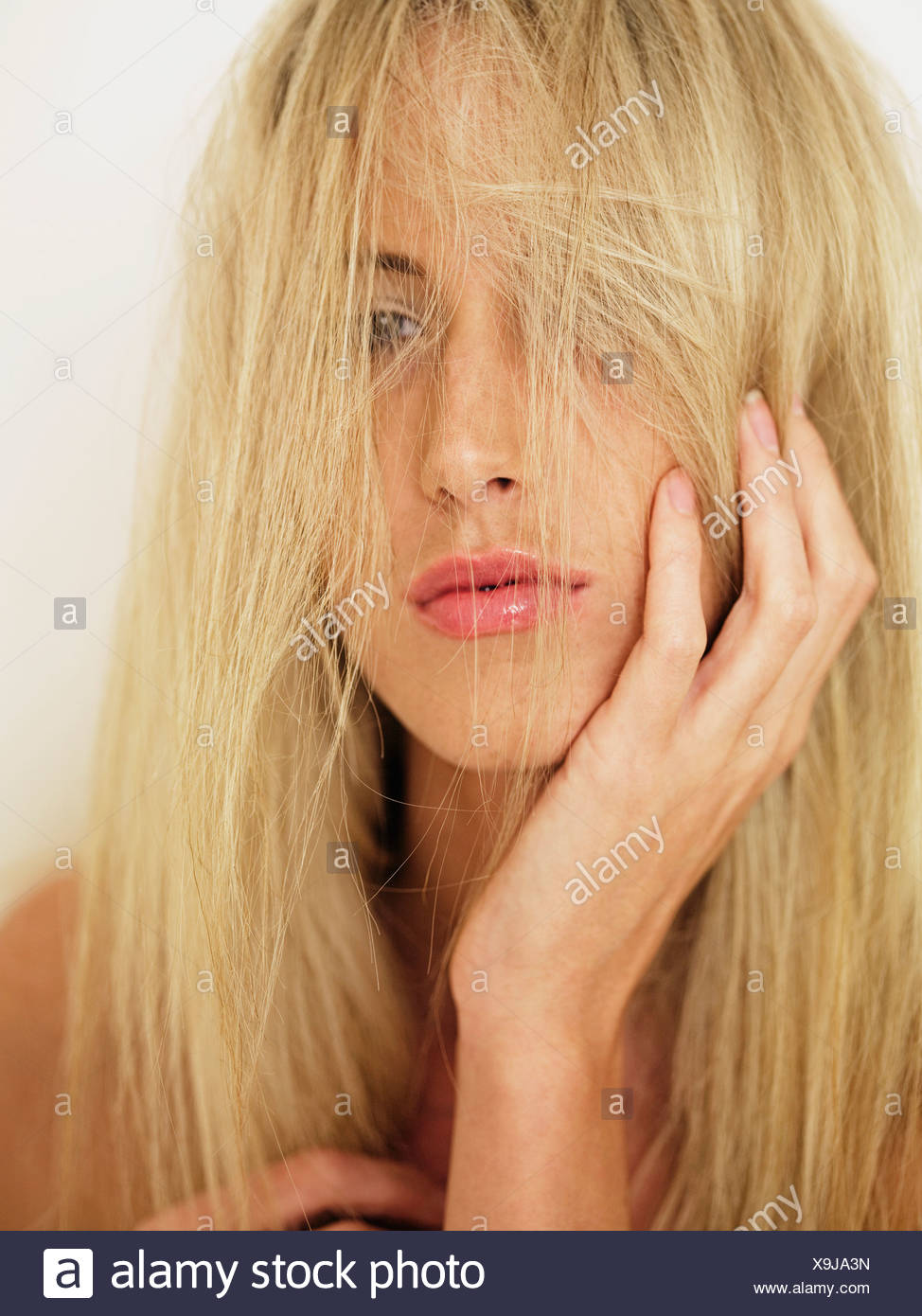 A woman with tousled hair, portrait - Stock Image