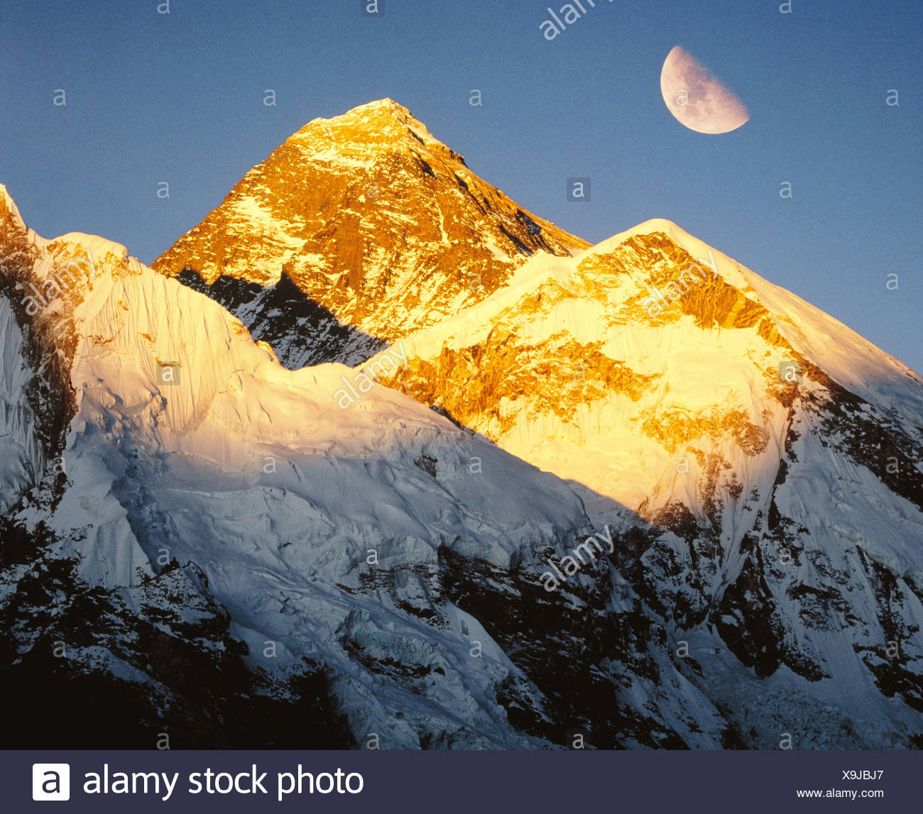 8. 846 ms. evening sun summit peak half moon crescent Himalayas Mount Everest mountain Nepal Asia - Stock Image