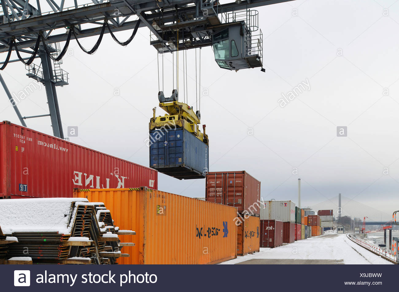Container handling via portainer at Bonn Harbour, snow-covered quay, Containerterminal Bonn, North Rhine-Westphalia, Germany, E - Stock Image
