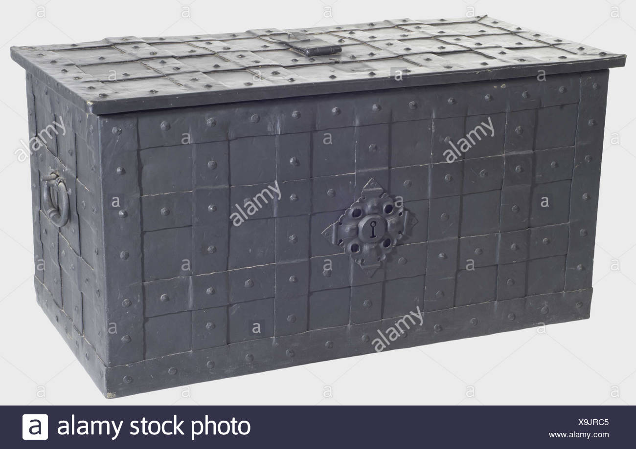 A large German war chest, 1st half of the 17th century. Iron chest reinforced with straps. Lateral handels and a false lock on the front. Lid with (supplemented) concealed keyhole cover, three hinges and twelve bolts. Later key. Dimensions 84.5 x 44.5 x 42 cm. historic, historical, 17th century, object, objects, stills, clipping, clippings, cut out, cut-out, cut-outs, storage, box, boxes, cabinet, chest, cabinets, chests, piece of furniture, pieces of furniture, furnishings, Additional-Rights-Clearances-NA - Stock Image
