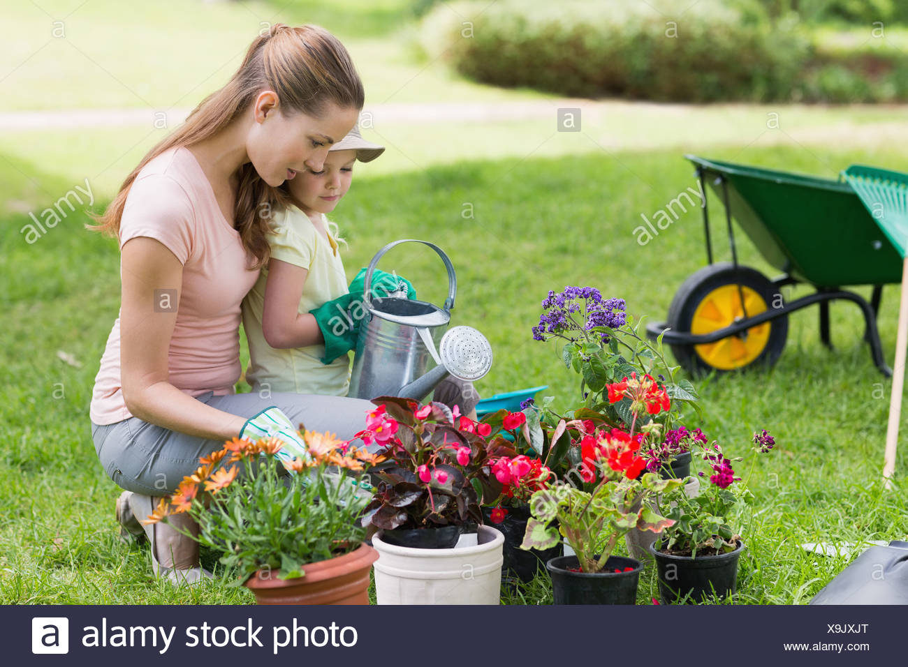 Mother and daughter engaged in gardening - Stock Image