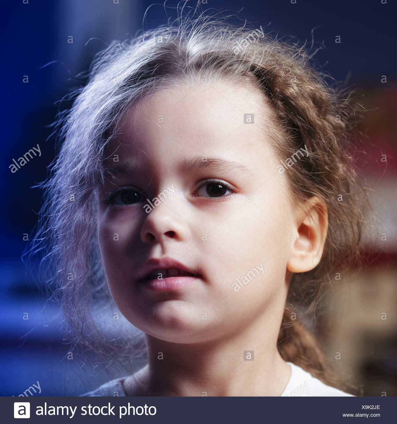 Little girl in darkness - Stock Image