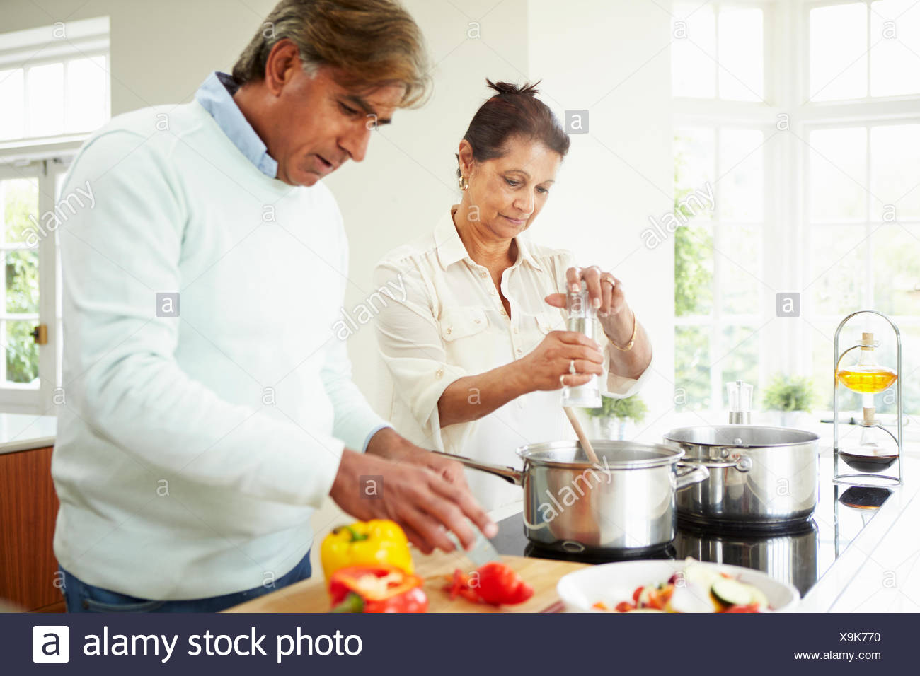 Senior Indian Couple Cooking Meal At Home Stock Photo 281320564 Alamy