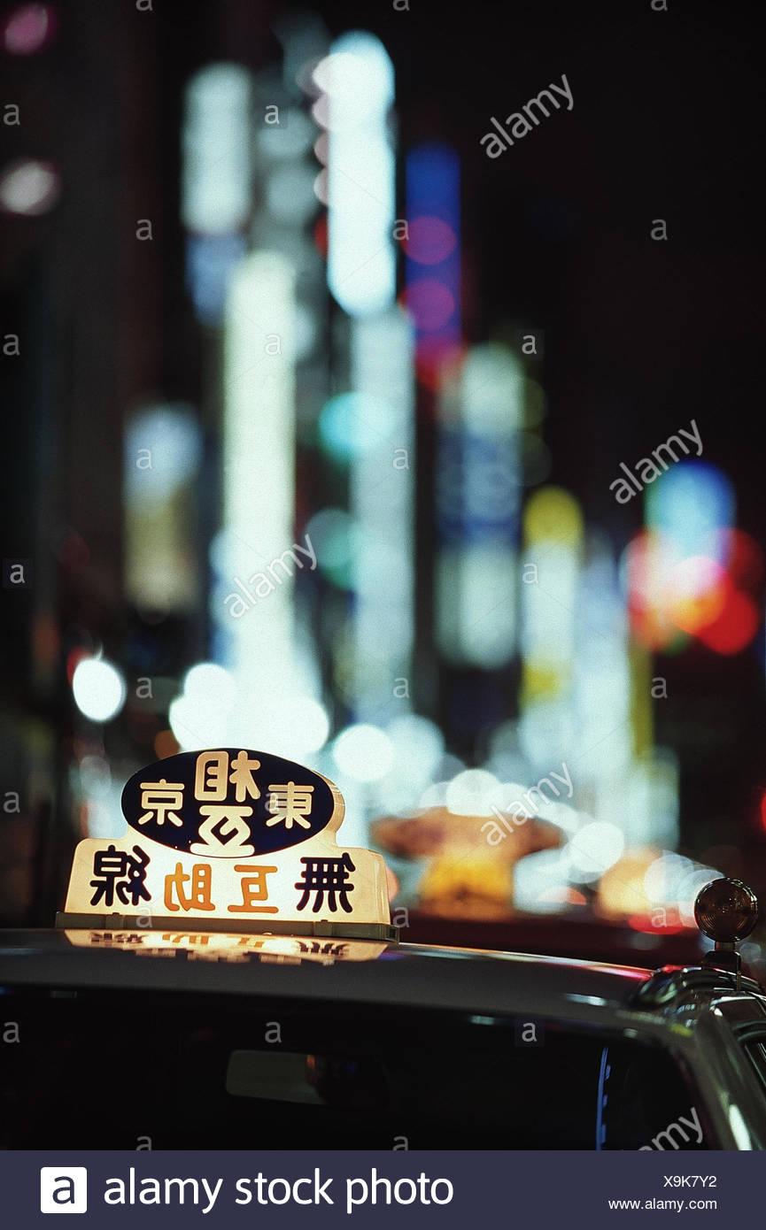 Japan, Tokio, Ginza, Taxi, Detail, Nacht  außen, Stadt, Verkehrsmittel, Tokyo-to, Personenbeförderung, Taxischild, Schild, Verkehr, fahren, Transport, Auto, Pkw, Leuchtreklame - Stock Image