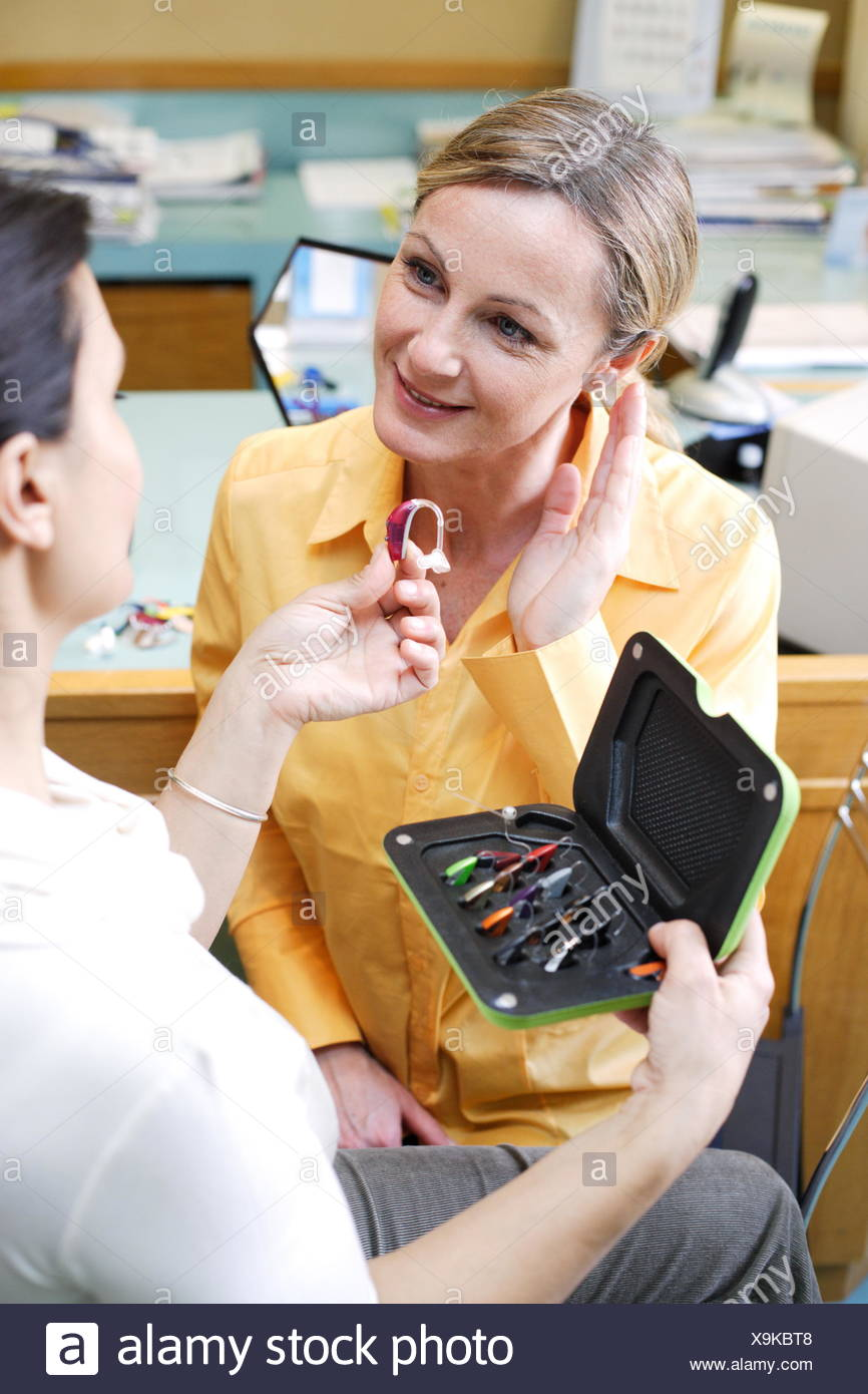 Hearing Aid Specialist Showing A Patient Different Types Of Hearing Aids Stock Photo Alamy