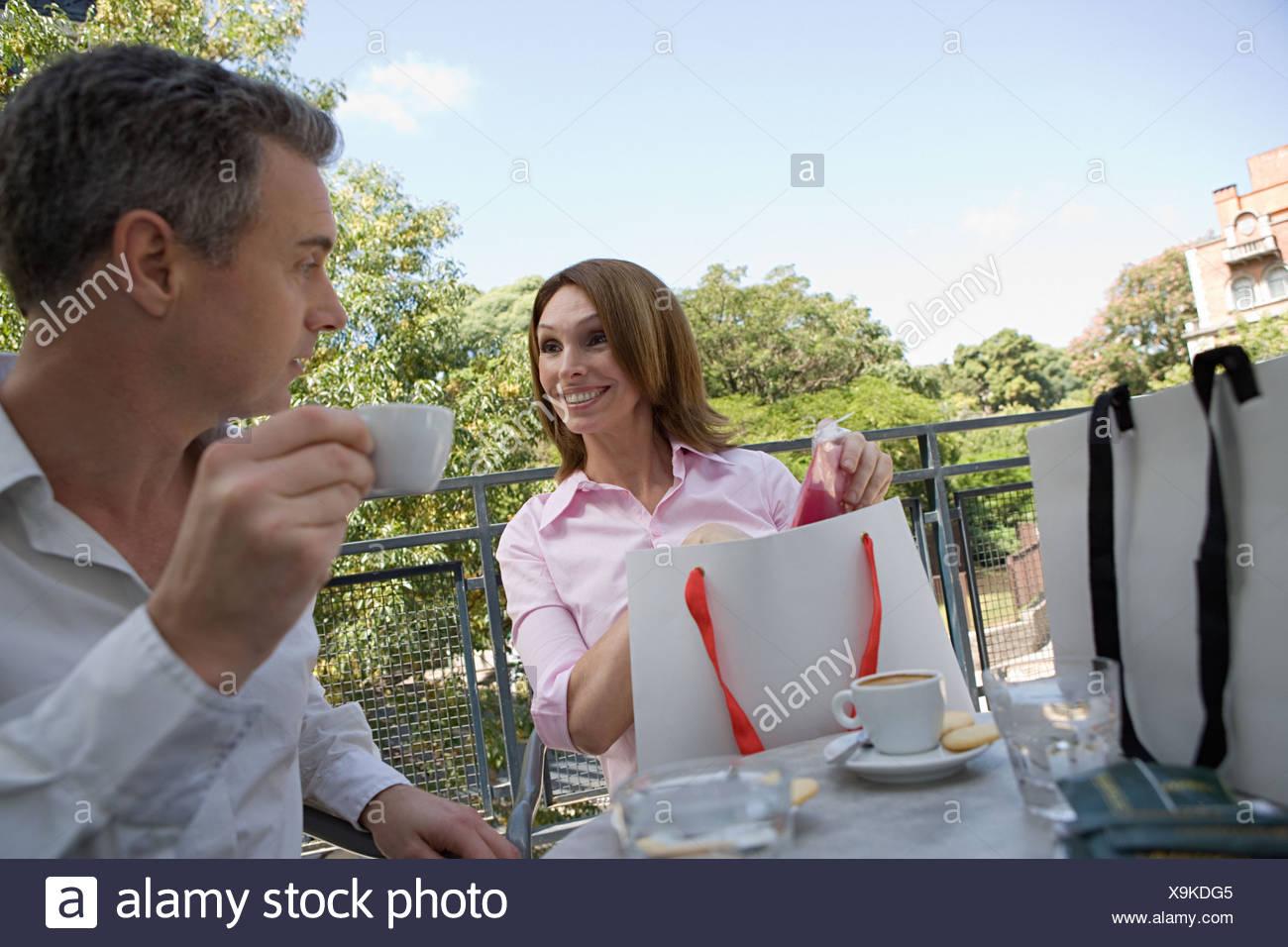 Couple sat at a café Stock Photo