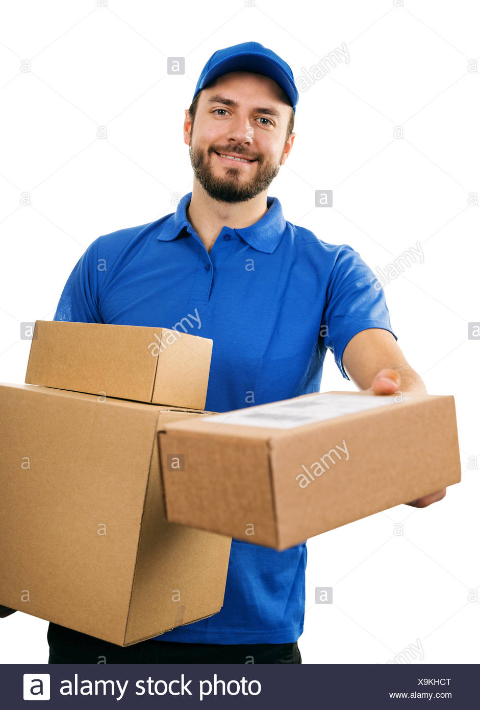 delivery service courier giving cardboard shipping box - Stock Image