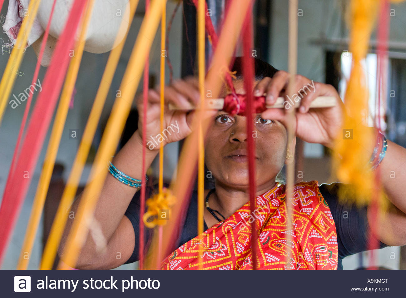 Weaver weaving, Ahilya Fort, Maheshwar, Madhya Pradesh, India, Asia Stock Photo
