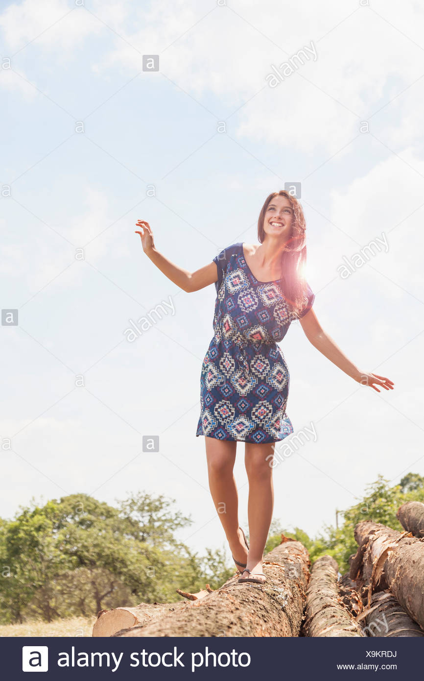 Teenager balancing on log, Roznov, Czech Republic - Stock Image