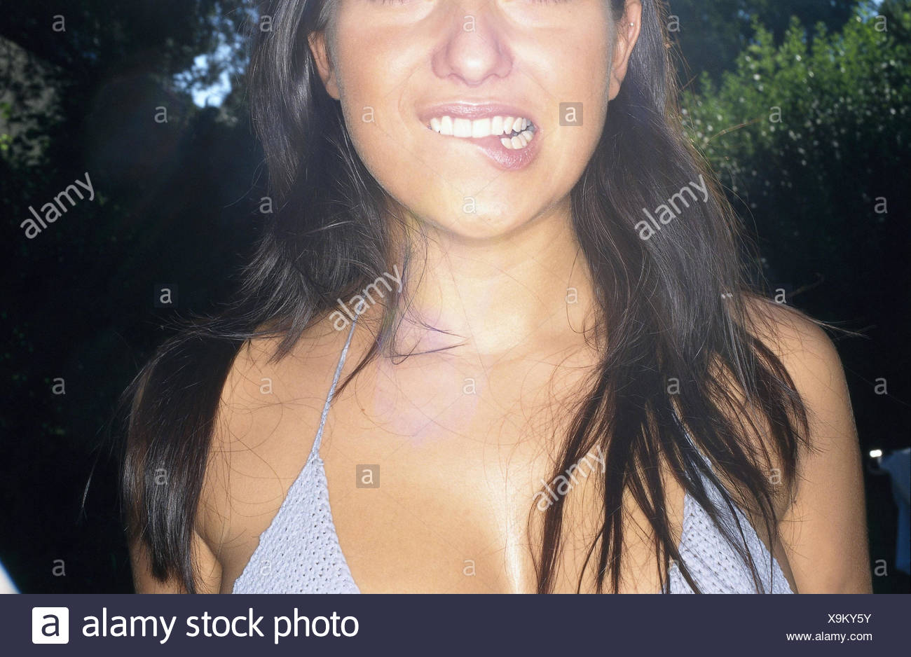 Woman, young, bikini, facial play, insecurity, doubts, detail, summer, outside, long-haired, dark-haired, crochet top, expression, doubt, scepticism, embarrassment, surprise, uncertainly, hesitate, indecision, undecided, very close - Stock Image