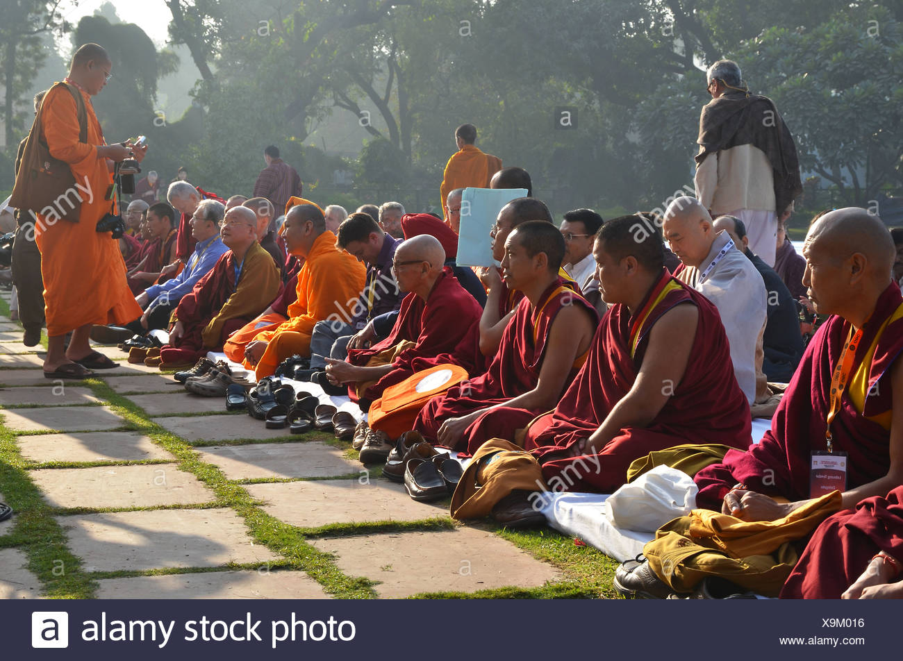 Monks from all Buddhist traditions gather for a communal prayer in their orange and red robes, Global Buddhist Congregation 2011 - Stock Image