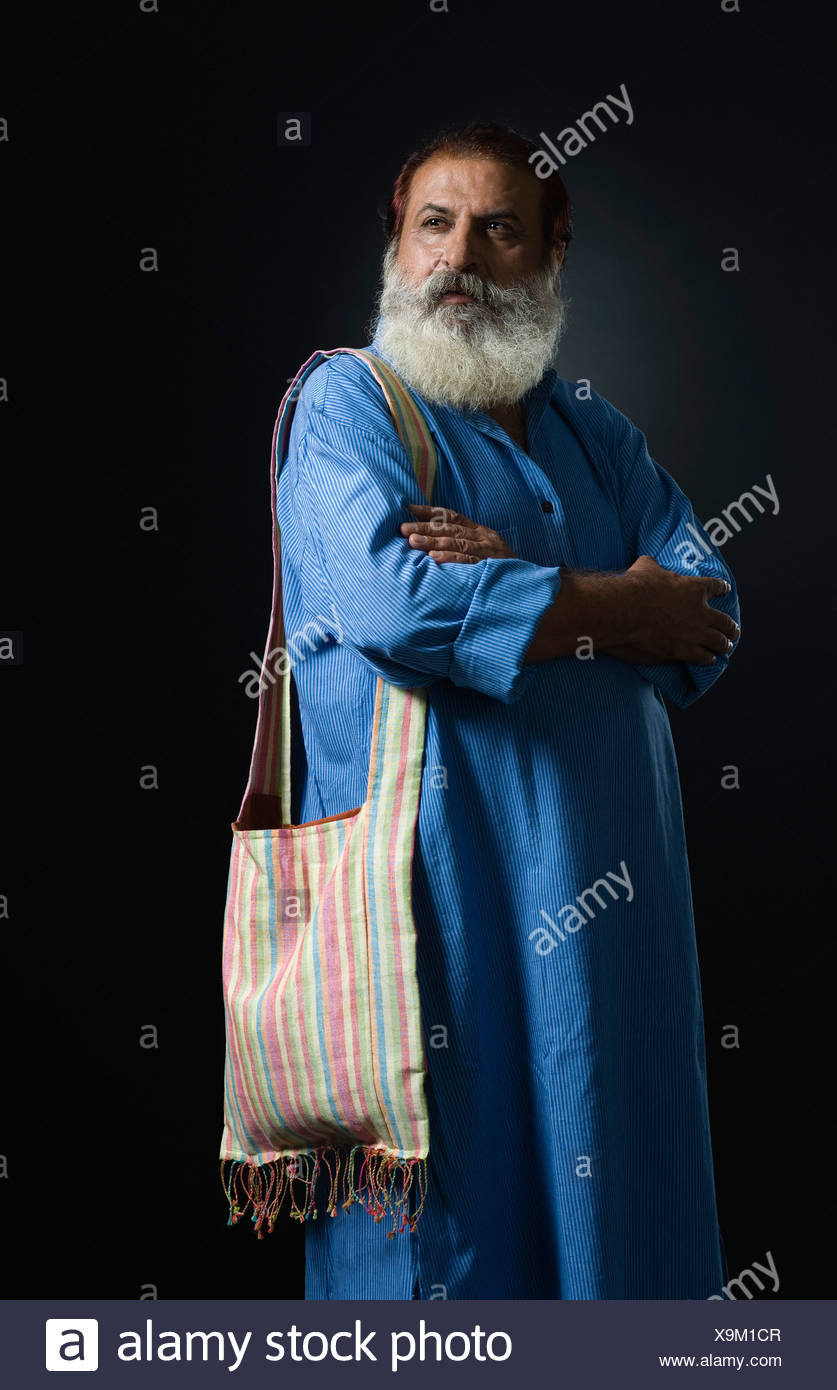 Philosopher standing with his arms crossed - Stock Image