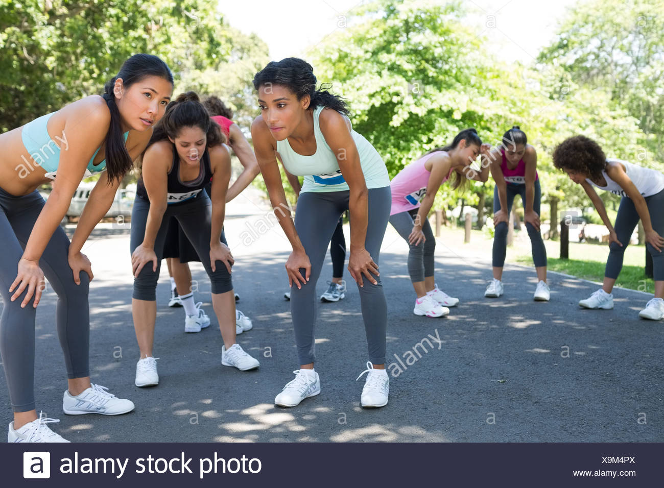 Runners taking a breather from the race - Stock Image