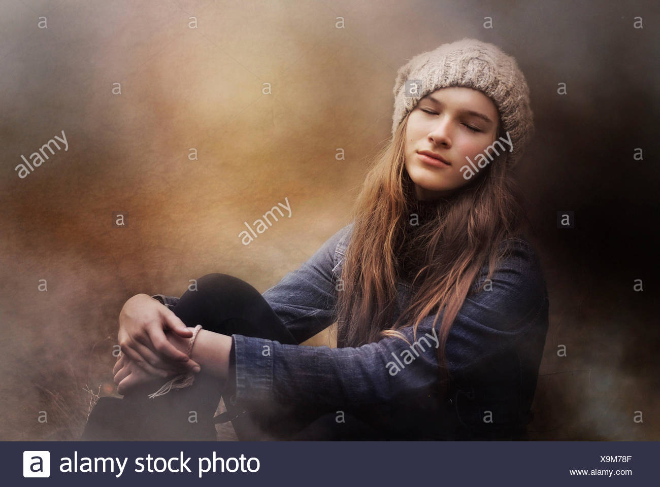 Teenage girl day dreaming - Stock Image