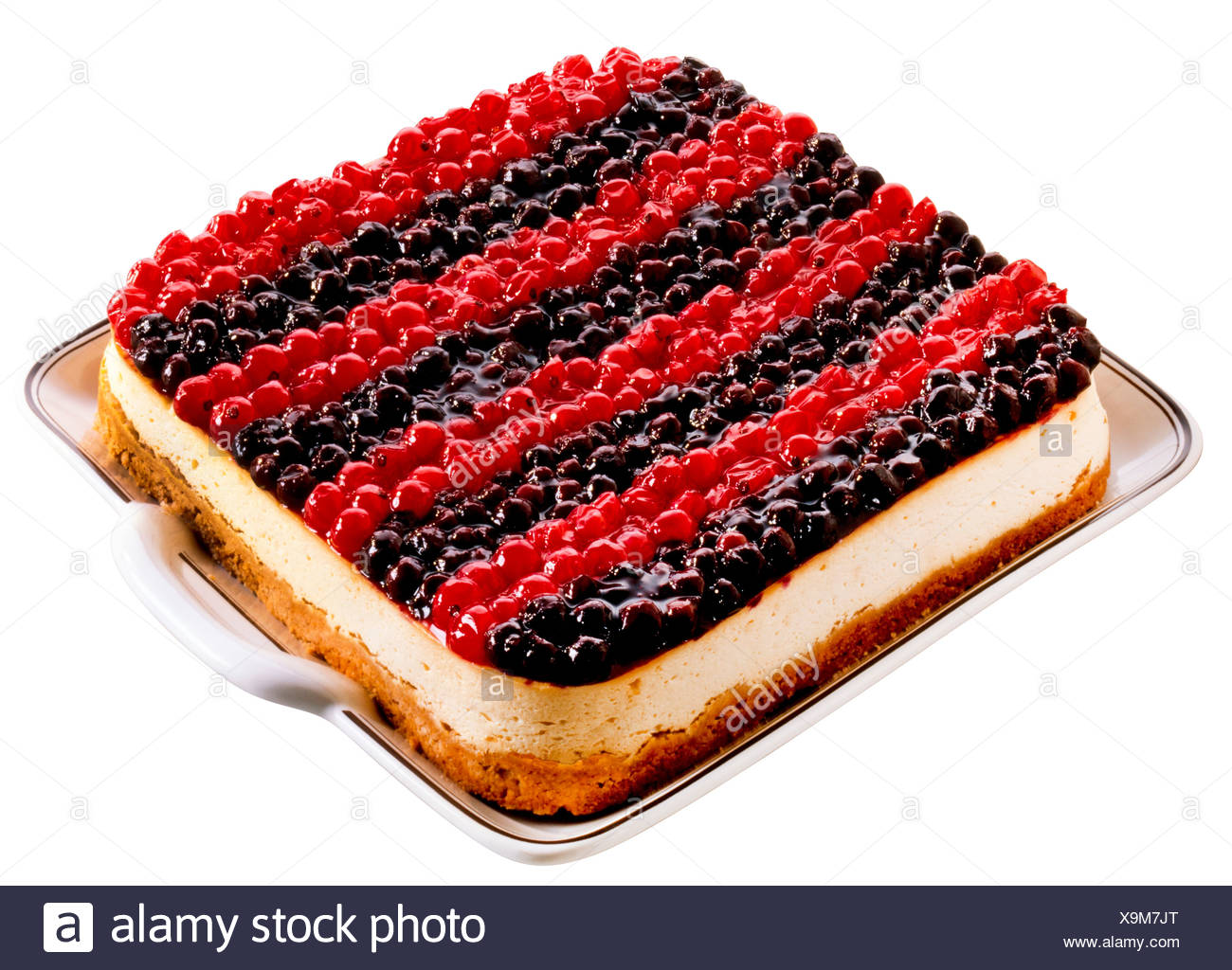 CUT OUT OF BLUEBERRY AND REDCURRANT CHEEESECAKE Stock Photo