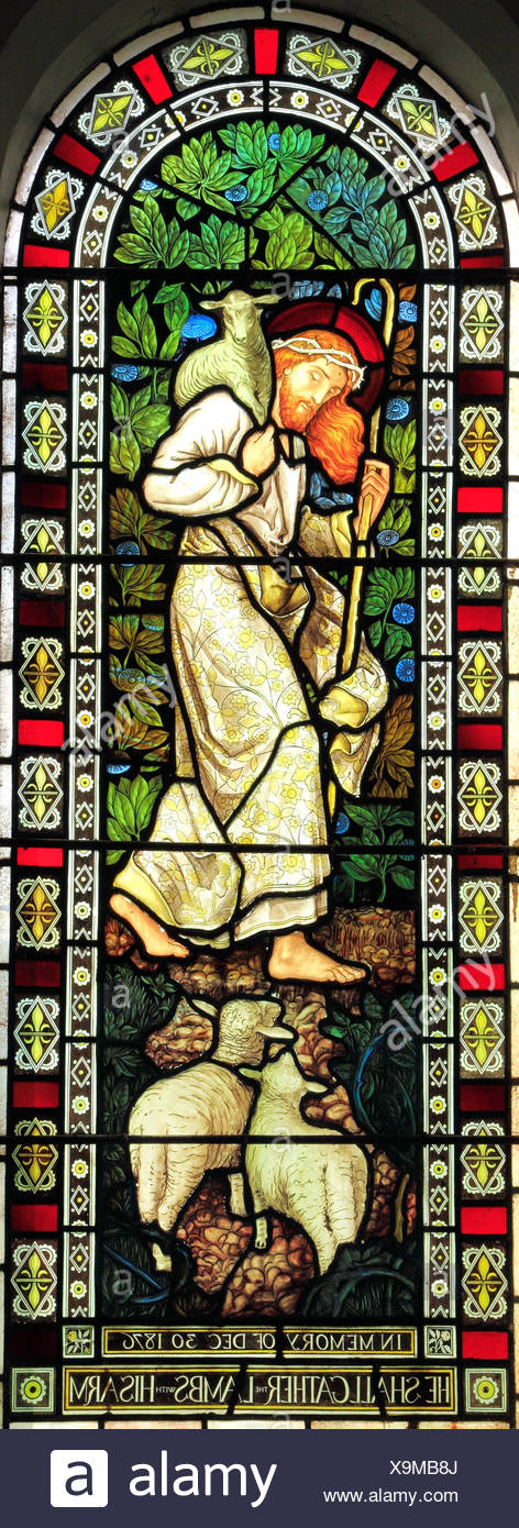 He shall gather the Lambs in his arm, Jesus, with crown of thorns, stained glass by J. Powell & Son, 1878, Houghton St. Giles, Norfolk, England, UK - Stock Image