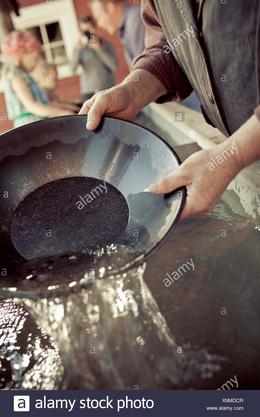 Prospector panning for gold - Stock Image