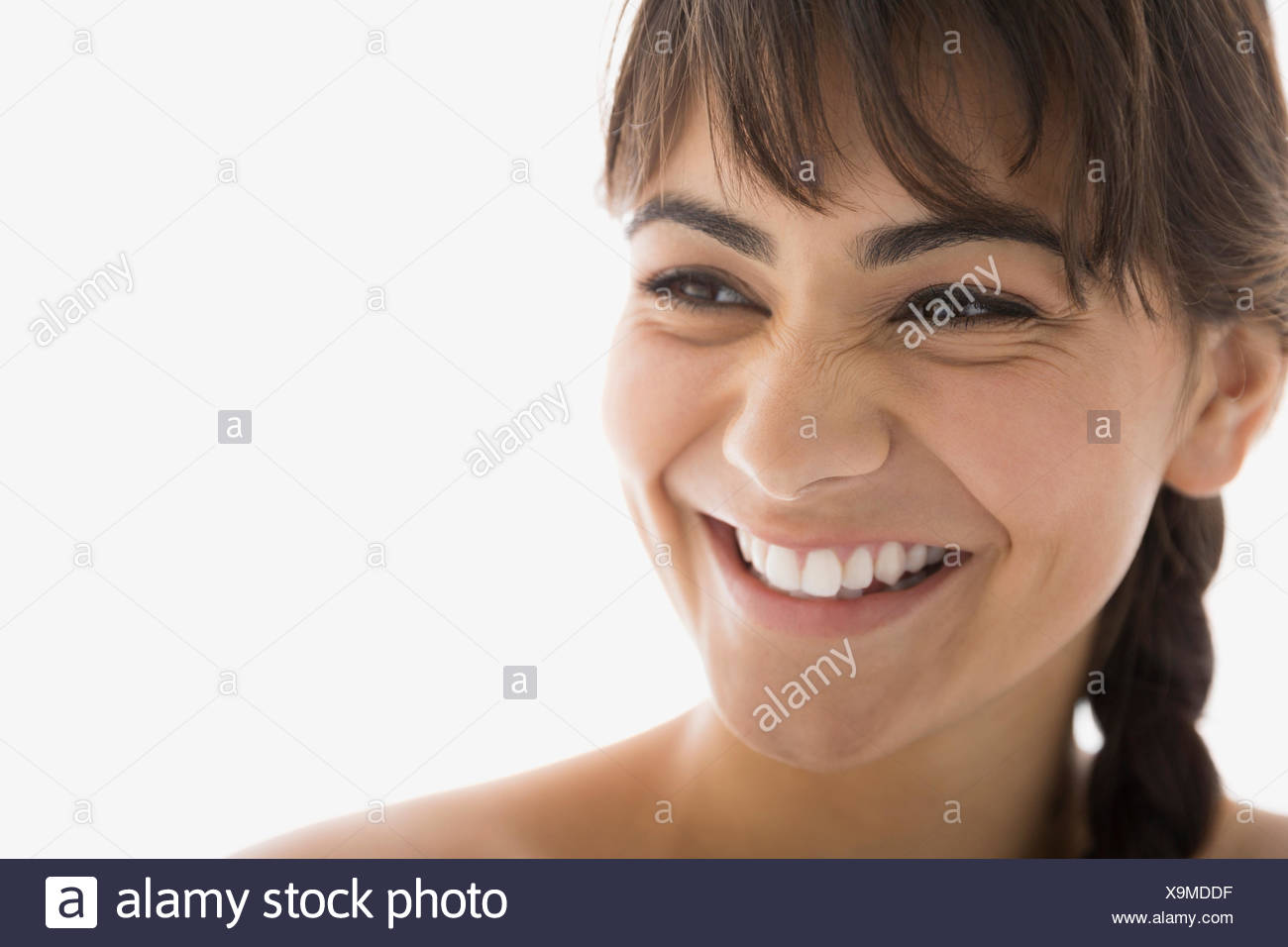 Close up of enthusiastic brunette woman looking away - Stock Image