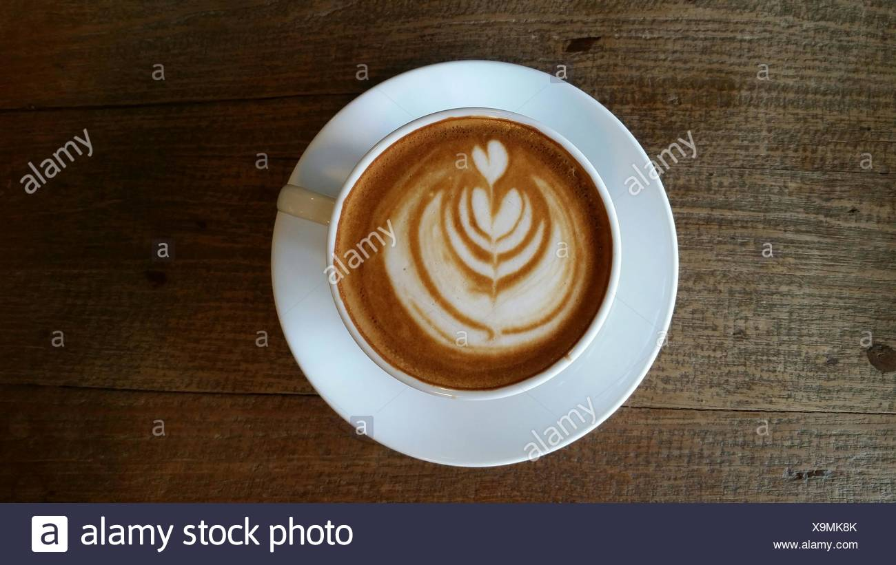 Directly Above View Of Coffee With Latte Art On Table Stock Photo