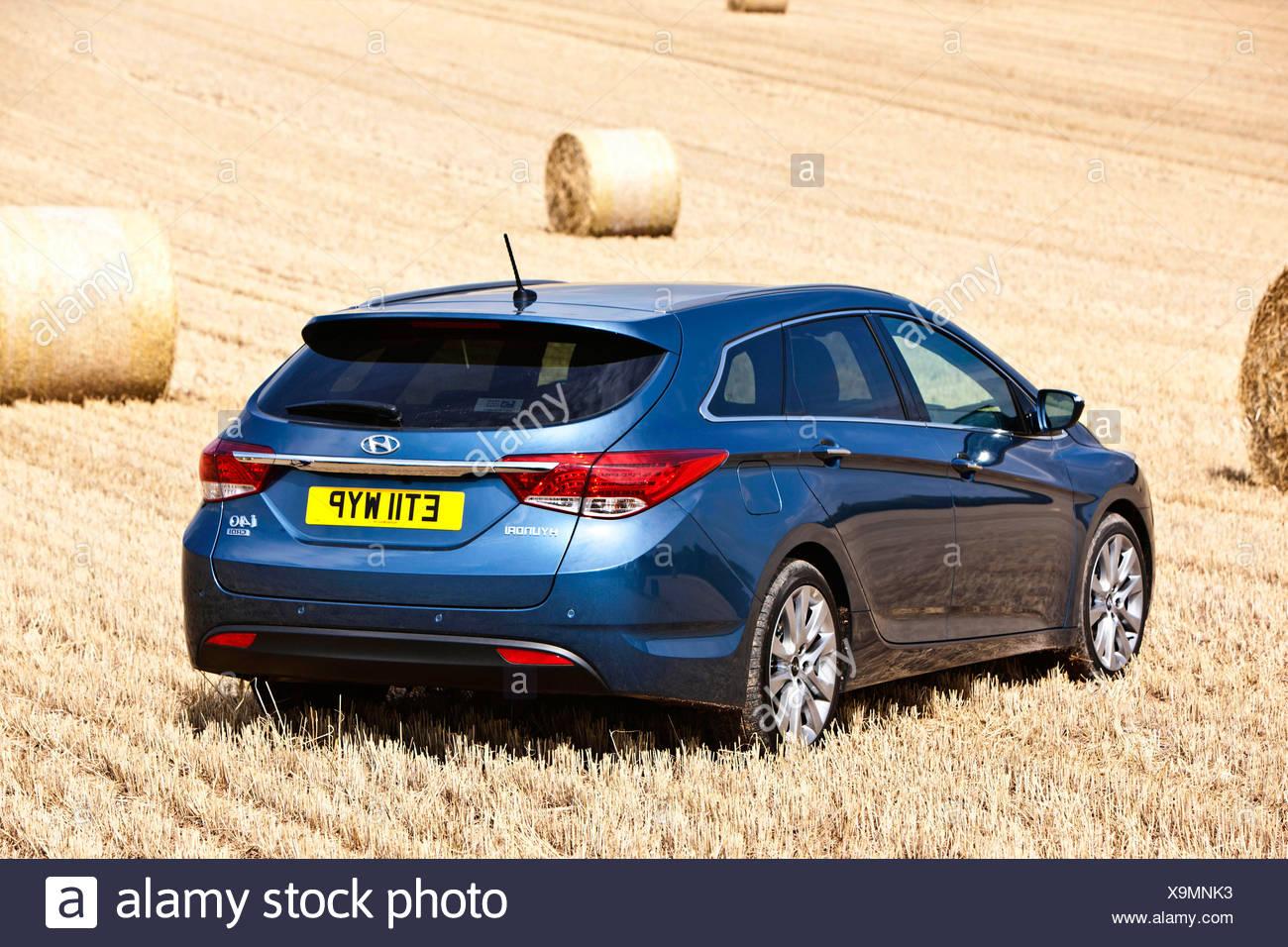 Hyundai i40, large family car, in a hayfield, Southampton, UK, 20 08 2012 - Stock Image