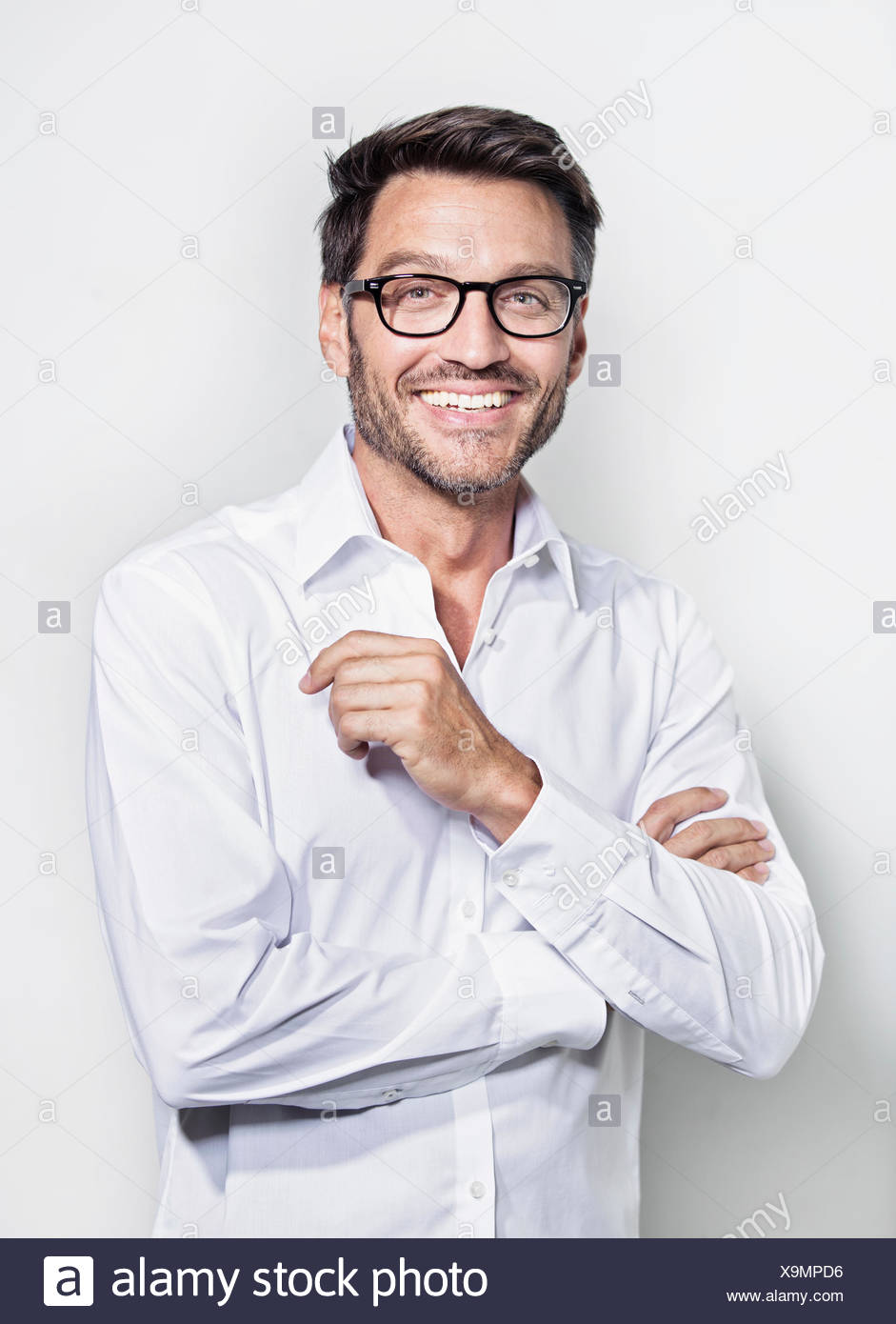 Portrait of mature man wearing glasses - Stock Image