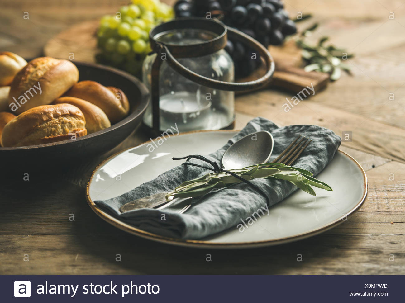 Fall Holiday Table Party Decoration Setting Plate With Linen Napkin Fork Spoon Candle Holder Fresh Grapes On Board Bread Buns Olive Tree Branch Stock Photo Alamy