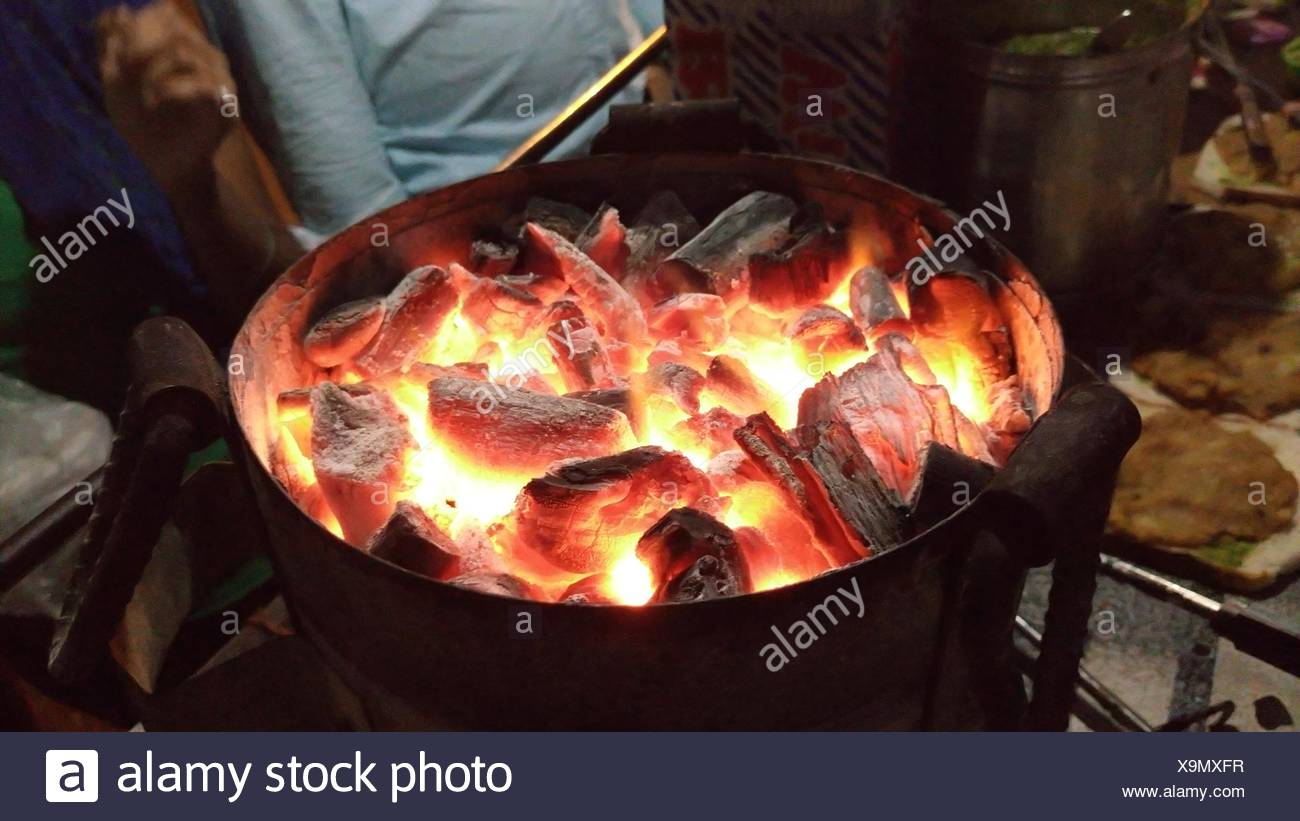 High Angle View Of Charcoal Burning In Old-Fashioned Stove - Stock Image