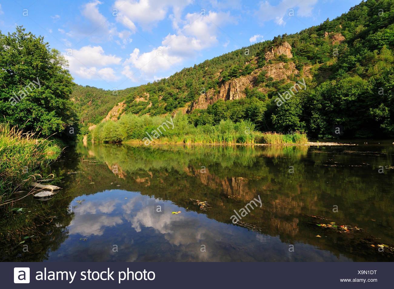 Reflections in the calm waters of the upper Loire River, Gorge de la Loire, Haute-Loire department, Auvergne, France Stock Photo