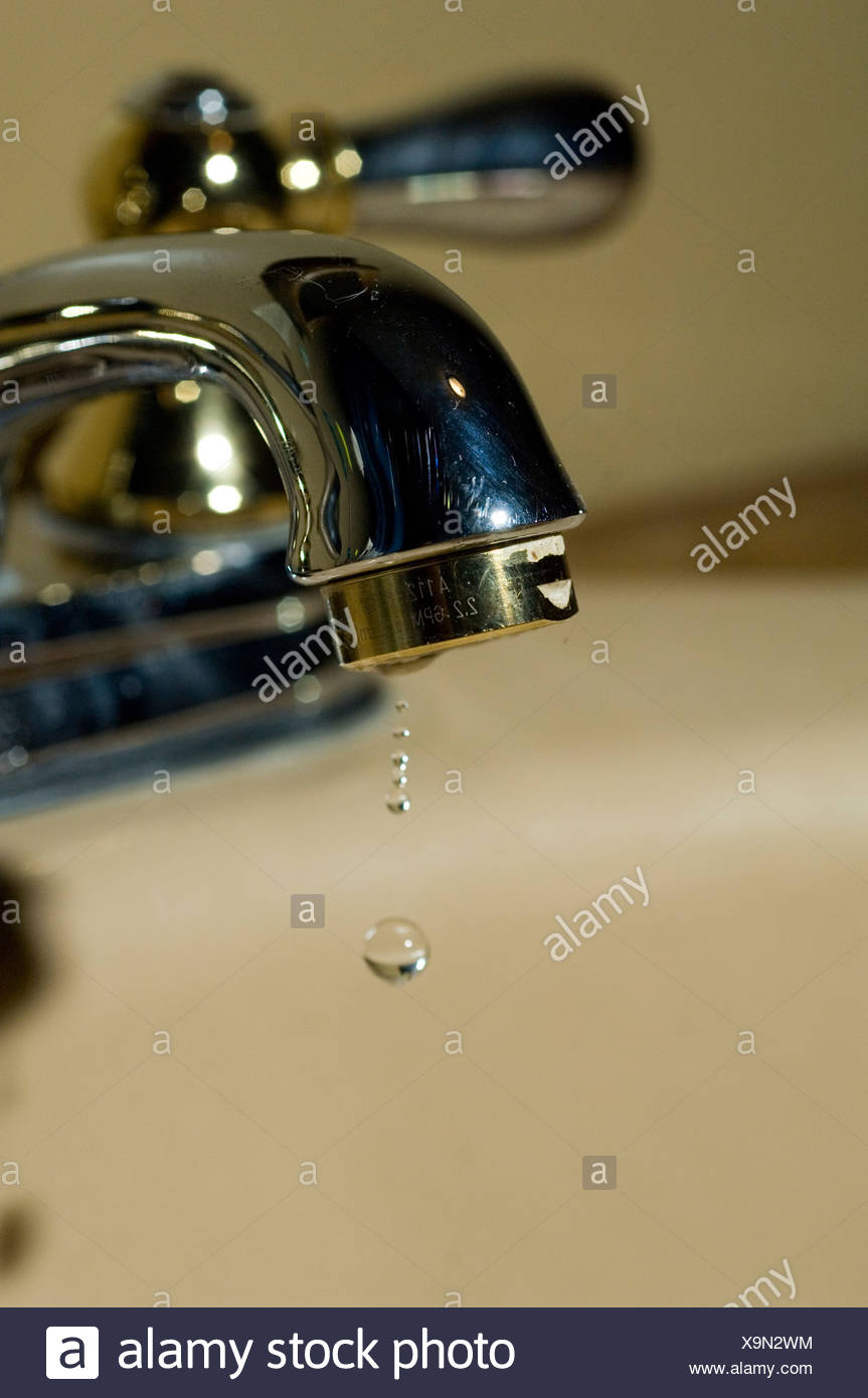 Water drop dripping from bathroom faucet, Ridgway Colorado, USA ...