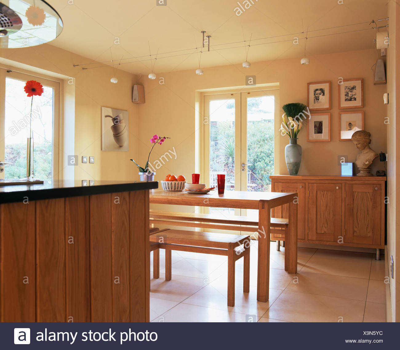 Simple Wood Table And Benches In Modern Kitchen Dining Room With Glass Patio Doors