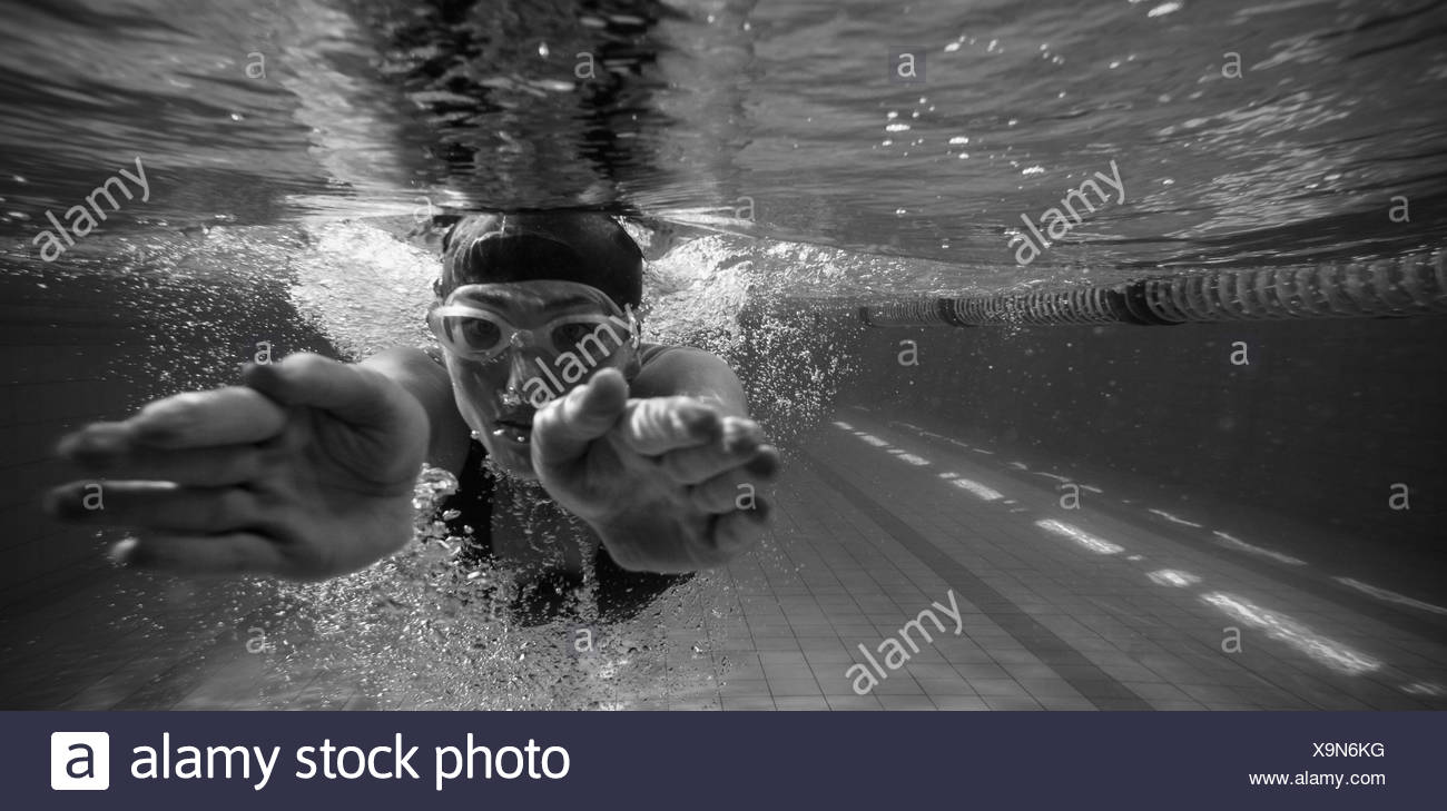 Athletic swimmer training on her own - Stock Image