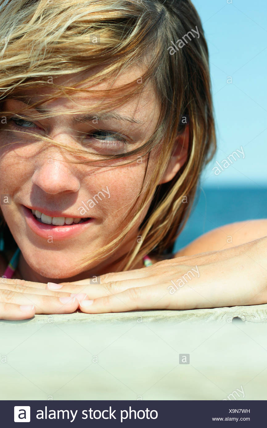 Italy, Sardinia, Young woman on beach, portrait, close-up Stock Photo
