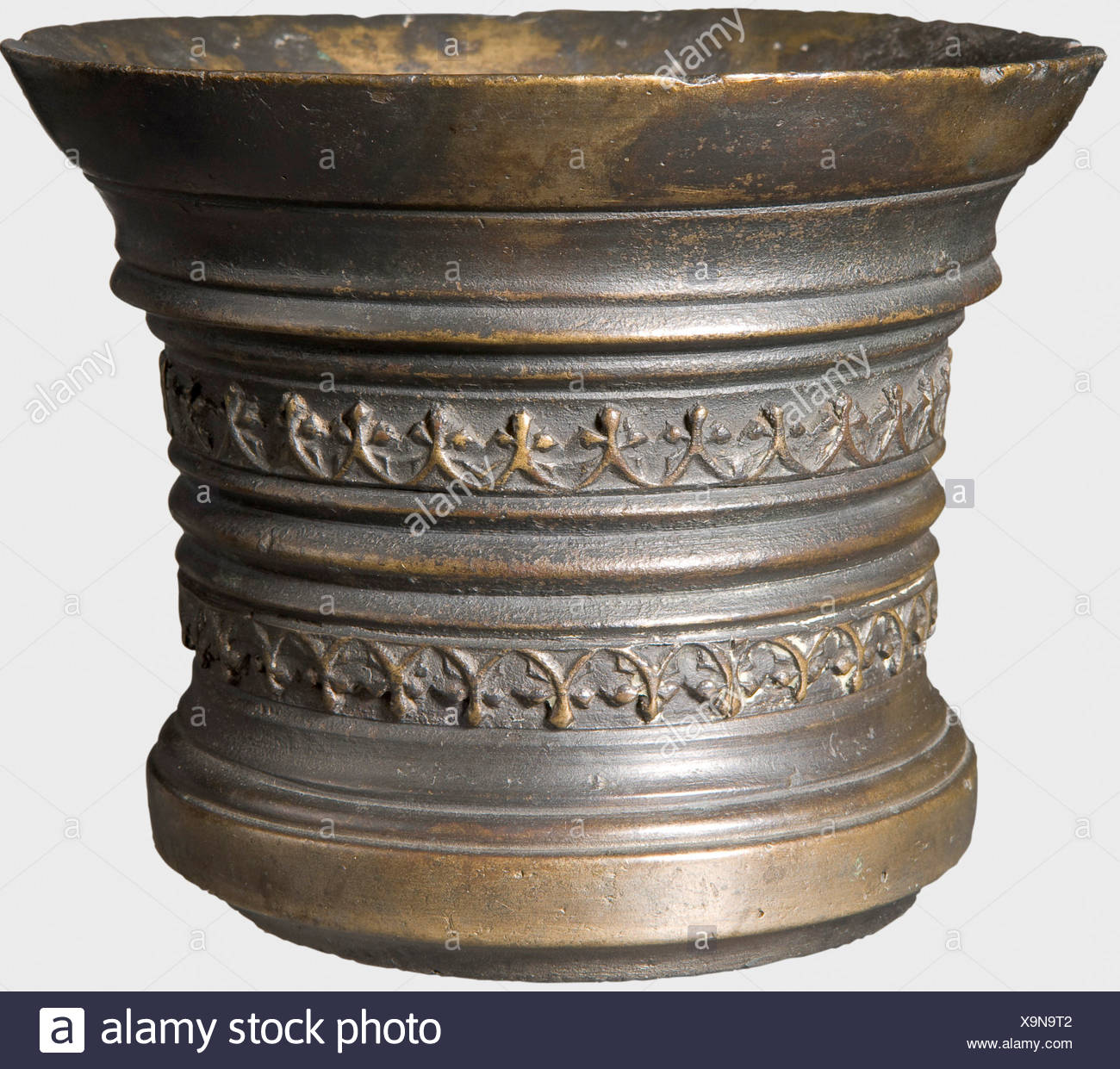 A Dutch bronze mortar, 16th century Bronze with darkened age patina. Cylindrical body with widely flared lip and stepped pedestal. Continuous banded sections with two Gothic tracery friezes. The lip with small nicks. Height 11.2 cm, diameter 14 cm. historic, historical, 16th century, handicrafts, handcraft, craft, object, objects, stills, clipping, clippings, cut out, cut-out, cut-outs, vessel, vessels, Additional-Rights-Clearances-NA - Stock Image