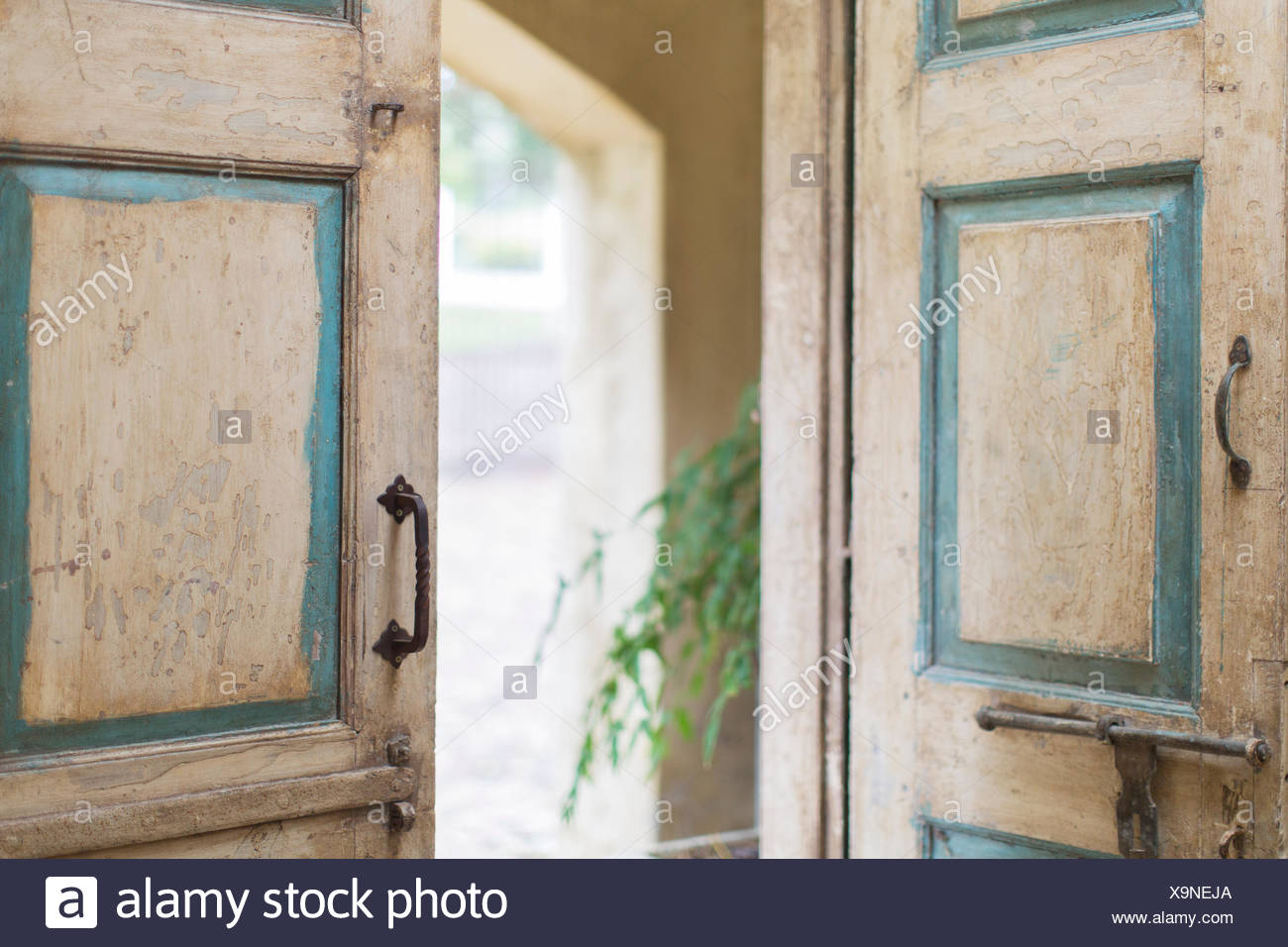 Close up of door and handles of rustic house - Stock Image
