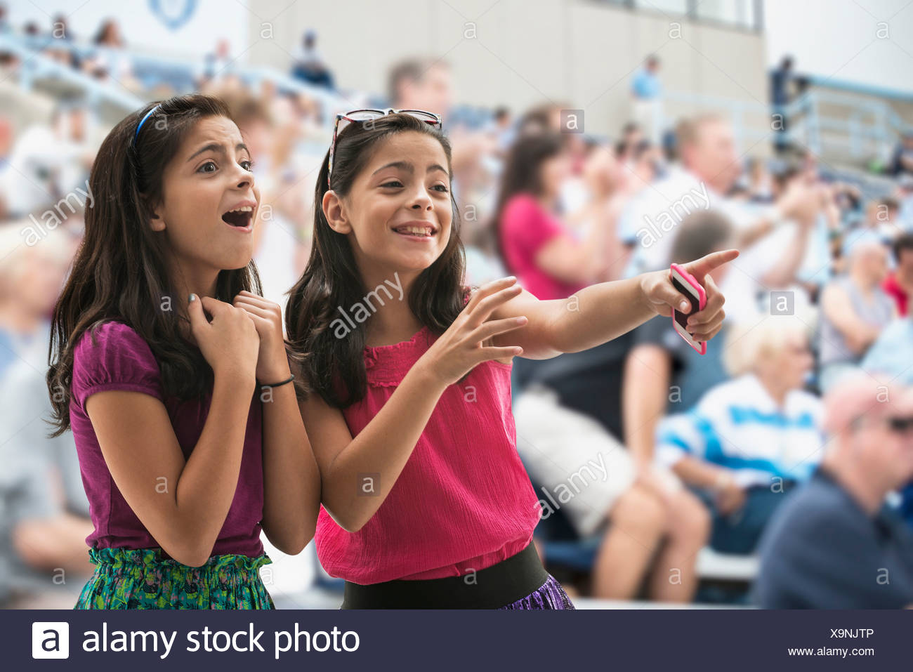 Adoring girls at pop concert - Stock Image