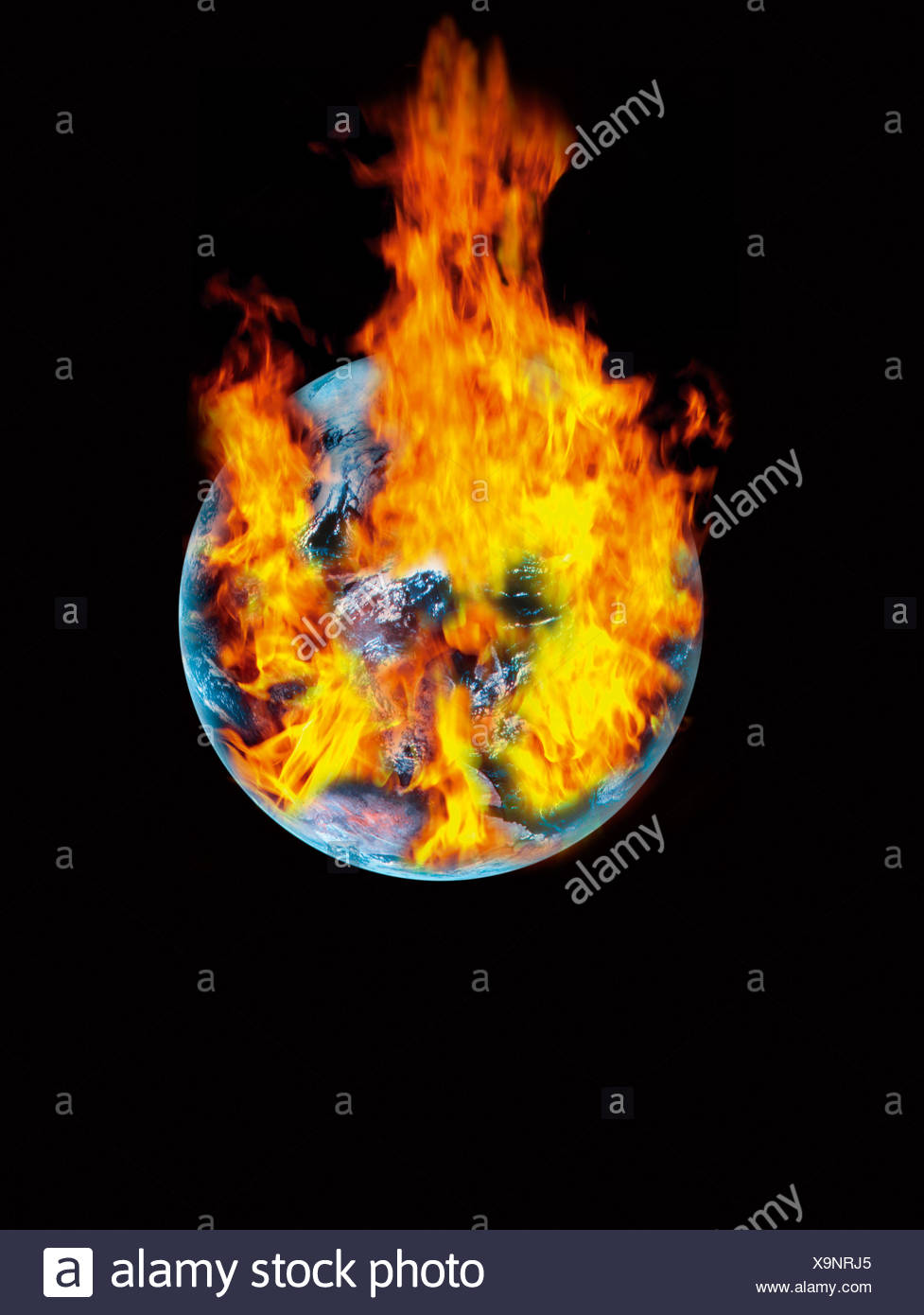 Earth with burning fire against black background - Stock Image