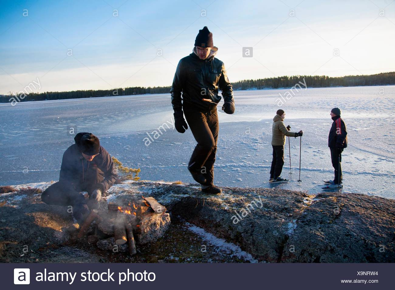 Family by the campfire Northern Sweden. - Stock Image