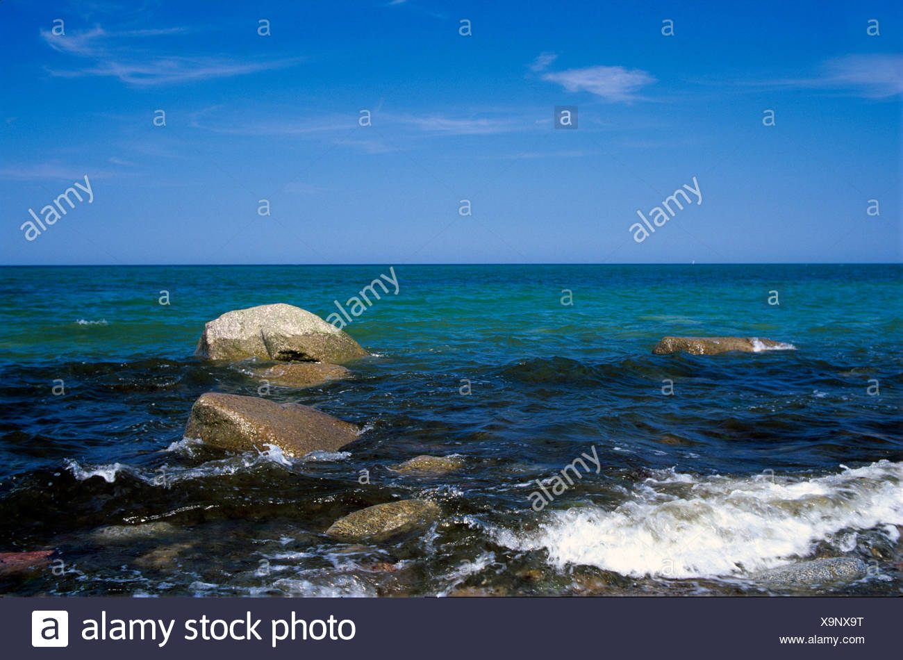 Rocks in the surf, Baltic Sea, Ruegen Island, Mecklenburg-Western Pomerania, Germany, Europe - Stock Image