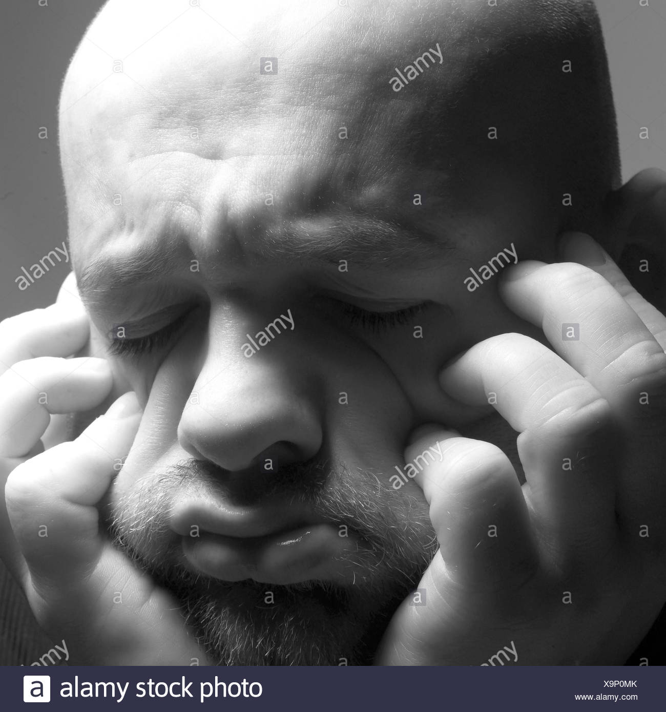 Man, head rest on, gesture, desperation, desperation, b/w, bald head, mood, thought, situation, negatively, hopelessness, grief, worries, depression, helplessly, depresses, think despondently, unhappily, suppressed, helplessness, misfortune, disappointmen - Stock Image