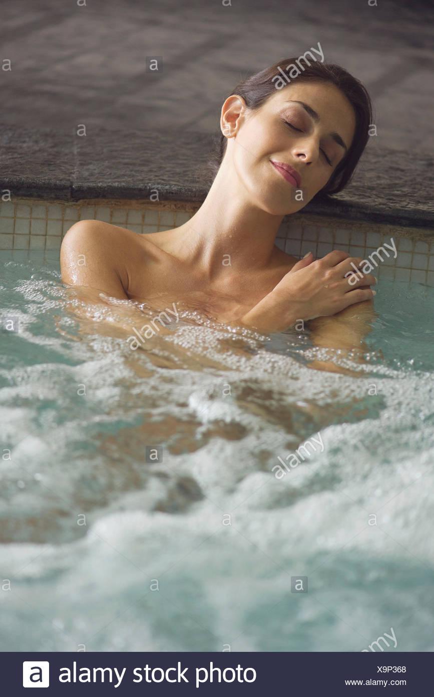 Woman soaking in spa pool - Stock Image