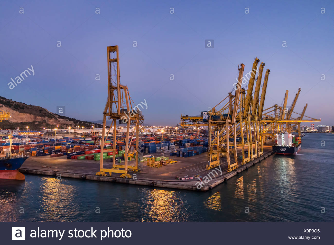Shipping terminal for export and import cargo containers, Barcelona, Spain. - Stock Image