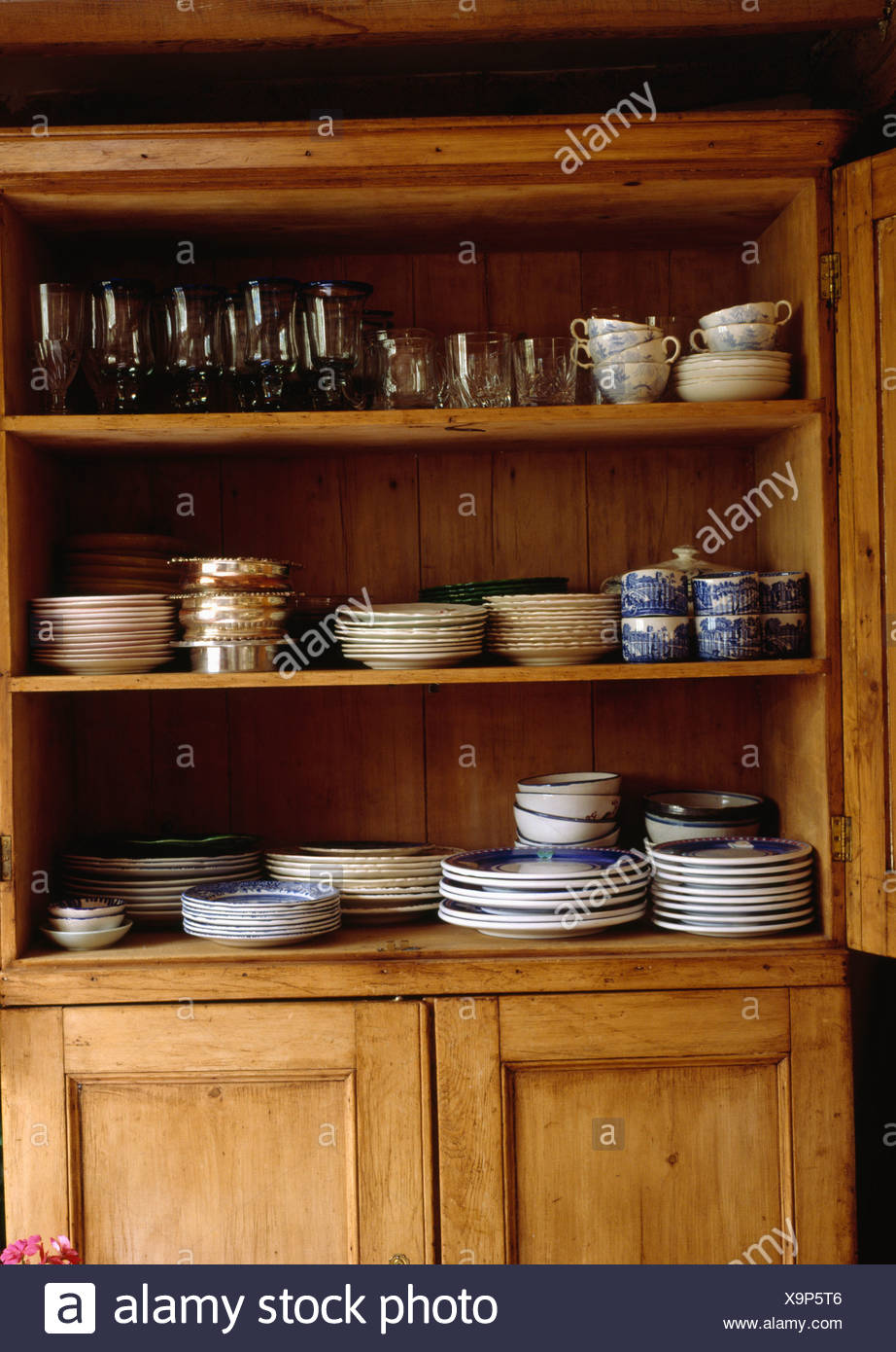 Picture of: China And Glassware On Antique Pine Dresser Stock Photo Alamy
