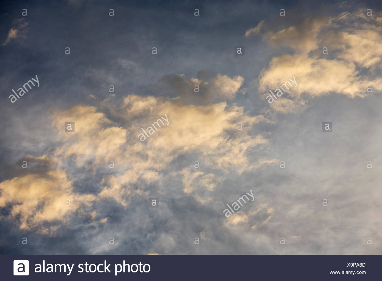 Altocumulus clouds against the high-level cirrostratus clouds, in the evening, Andalusia, Spain - Stock Image