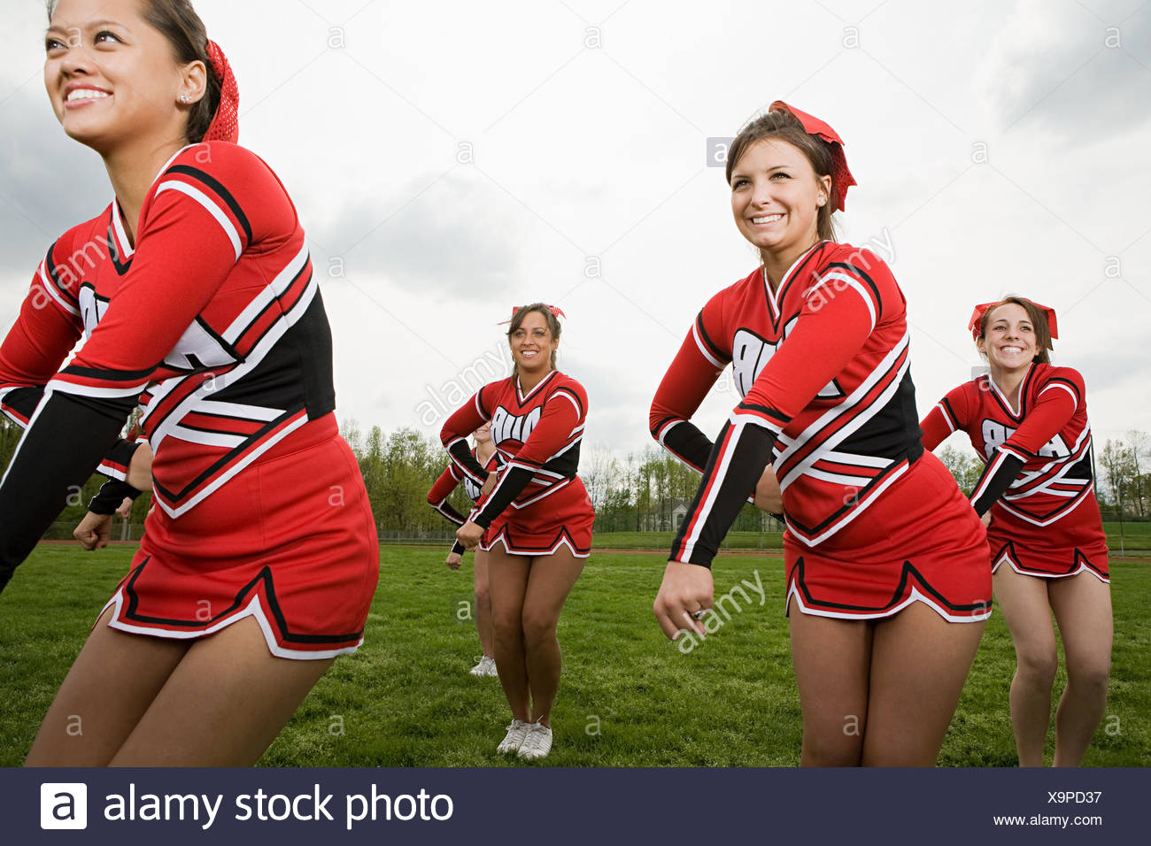 Cheerleaders performing routine - Stock Image